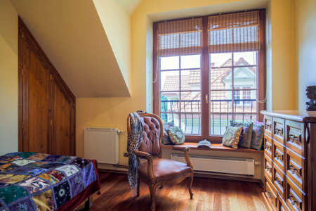 cosy: Picture of cosy bright room with colonial style armchair