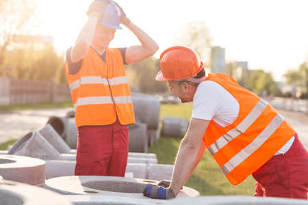 tiring: Construction workers are so tired that they are laughing Stock Photo