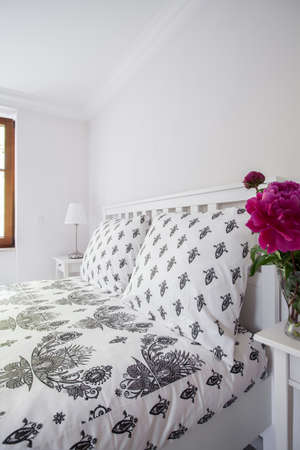bedding: Close up of black and white decorative neat bedding