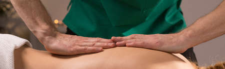 manuals: Woman having back massage in spa center Stock Photo