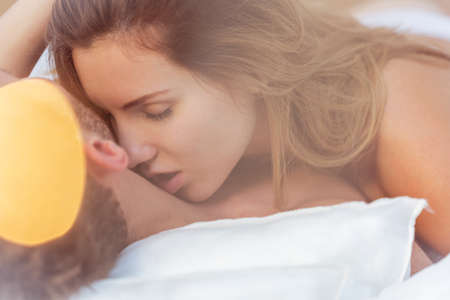 kissing lips: Close-up of alluring woman kissing male neck Stock Photo