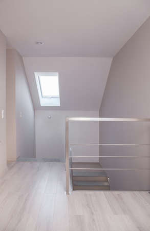 commodious: Picture of light corridor with stairs and chromed balustrade