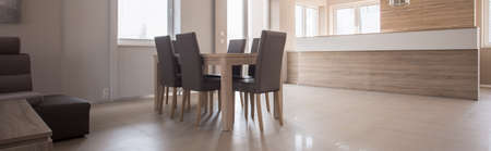 wood furniture: Panorama of simple wooden dining table with comfortable chairs