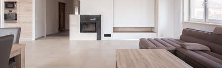 Panorama of commodious living room with fireplace Stock Photo