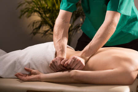 therapy room: Close-up of physical therapist doing medical massage Stock Photo
