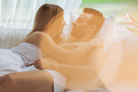 Couple during romantic scene in the bedroom