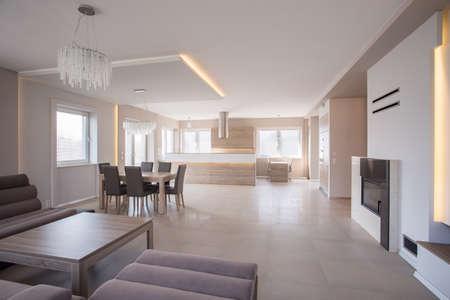 commodious: Photo of roomy interior with elegant sofa set