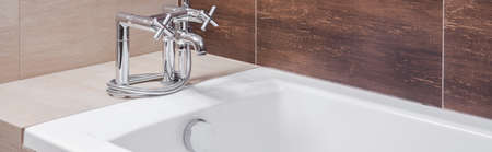 commodious: Panoramic view of white bathtub with silver old style tap Stock Photo