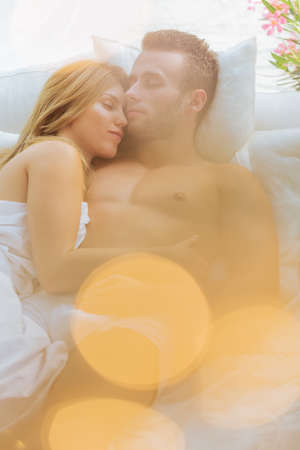 nude wife: Image of embraced couple sleeping in bed
