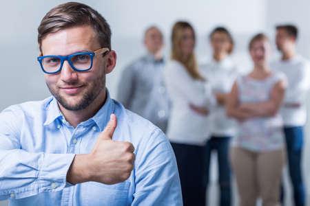 親指を出て成功した実業家のイメージ 写真素材