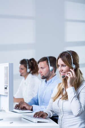 center agent: Young attractive people working in call center Stock Photo