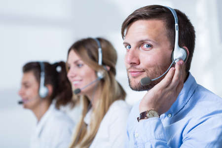 group of men: Close-up of support phone operators in headset Stock Photo