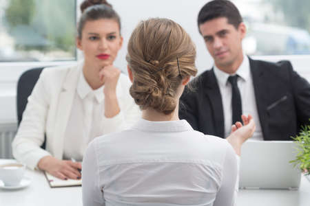 Young woman and recruitment procedure in corporation
