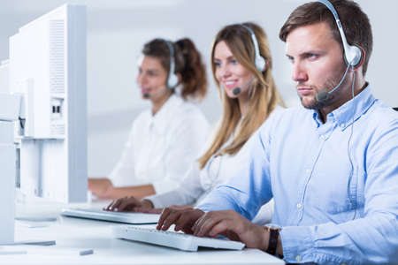 center agent: People with headsets working in customer service Stock Photo