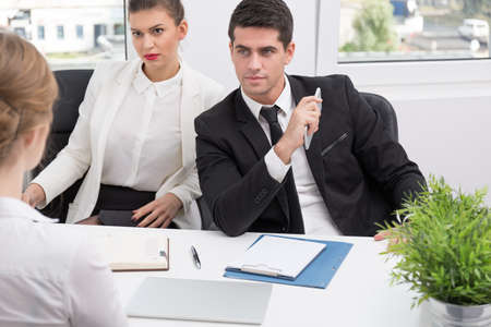 Young female applicant and professional competence test Stock Photo