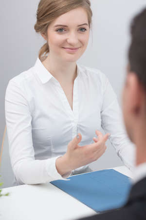 probation: Picture of young female applicant during psychometric test Stock Photo