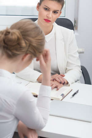 lady boss: Female demanding boss and disciplinary conversation with employee