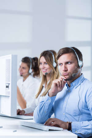 telephonist: Customer service representatives sitting at the table