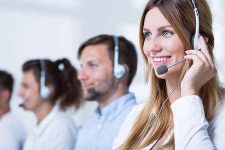 customer: Smiling customer service representative talking with client Stock Photo