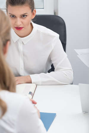 demanding: Job interview meeting with female demanding boss Stock Photo
