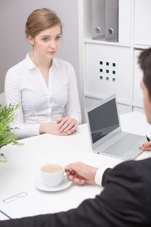 first job: Young stressed woman on first job interview