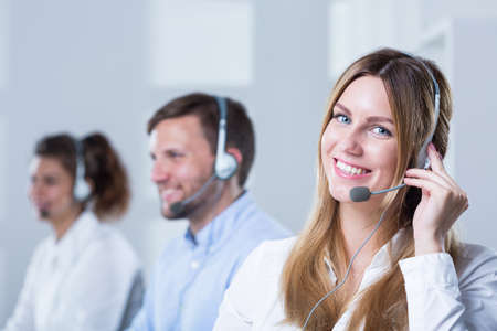 customer assistant: Group of people with headsets working in call center Stock Photo