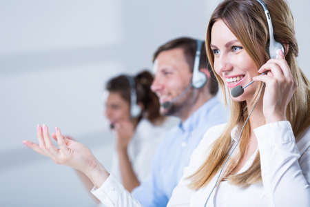 headset woman: Picture of support phone operators in headset Stock Photo