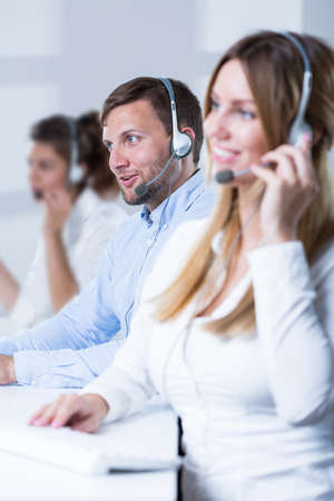 phone support: Young call center operators talking with clients
