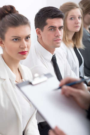job qualifications: Stressed students and woman announcing exam results