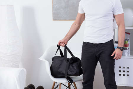 going: Fit man with gym bag going on the workout