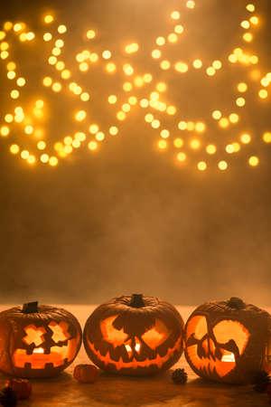 Picture of illuminated carved halloween pumpkins lanterns