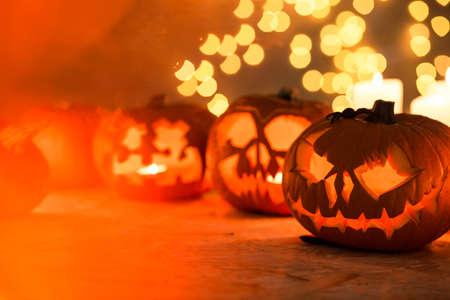 halloween decoration: Scary Halloween pumpkins lanterns on the table