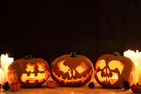 Picture of three carved halloween pumpkin lanterns 스톡 콘텐츠