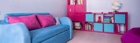 small room: Panorama of new design colorful furniture in girl room Stock Photo