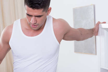 sportsmen: Close-up of muscular man training at home