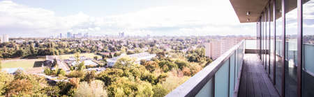 lifestyle outdoors: Panoramic view from large balcony of modern apartment Stock Photo