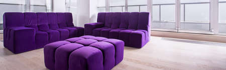 modern apartment: Panorama of bright contemporary lounge interior with purple furniture