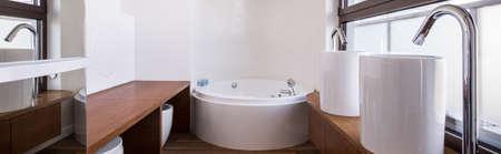 washbasins: Panorama of stylish wooden bathroom with new design washbasins
