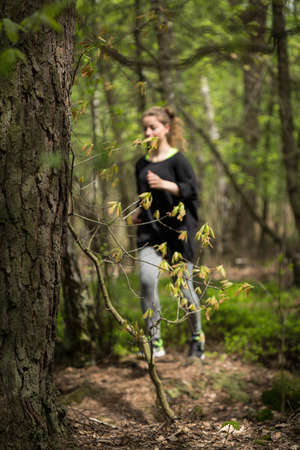 keeping fit: Picture of attractive sportive girl keeping fit outdoors