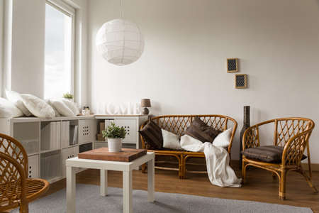 loveseat: Picture of stylish wicker loveseat and two chairs Stock Photo