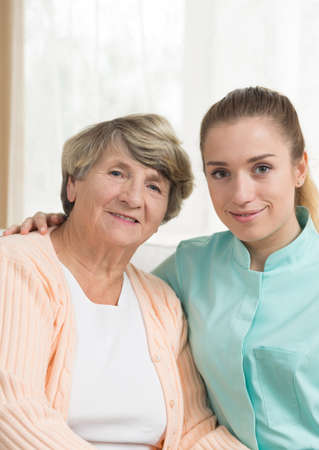 retiree: Female retiree and nurse in nursing home Stock Photo