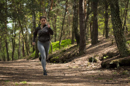 enduring: Picture of female enduring runner preparing for marathon
