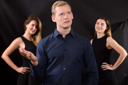 narcissistic: Two beauty ladies and man with hard decision