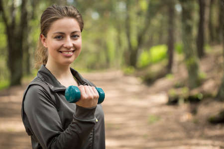 girl working out: Image of sporty girl working out wih dumbbells