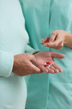 medicament: Close-up of nurse giving medicament for hypertension Stock Photo