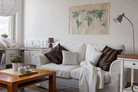 sitting room: Image of comfortable white double sofa in day room