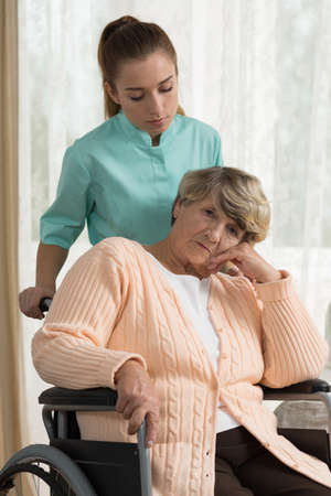 retiree: Disabled female retiree living in residential home Stock Photo