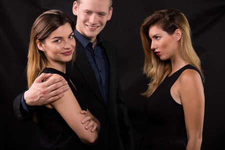 seductive couple: Beauty girl feeling jealous of other woman Stock Photo