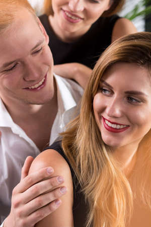 narcissistic: Close-up of macho surrounded by beauty women Stock Photo