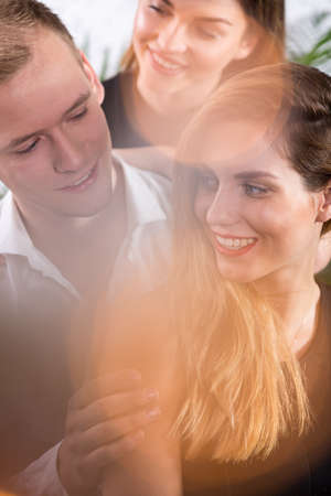 narcissistic: Three people flirting together - romance triangle concept
